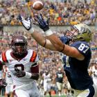 Pitt's Mike Shanahan hauls in a 40-yard reception against Virginia Tech's Detrick Bonner during the Panthers' 35-17 upset of the Hokies.