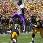 Northern Iowa running back David Johnson jumps over Iowa defensive back B.J. Lowery during the first quarter of the Hawkeyes' 27-16 victory the Panthers.