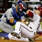 Dodgers catcher A.J. Ellis tags out Diamondbacks' Miguel Montero as he tries to score.