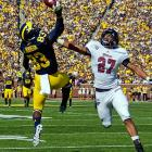 Michigan wide receiver Jerald Robinson attempts to catch a pass in the end zone while under pressure from UMass defensive back Darren Thellen.