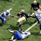 Vanderbilt wide receiver Wesley Tate  is brought down by Presbyterian defenders L. J. Perry  Mark Williams and Keyadd Miller in the first quarter of Vanderbilt's 58-0 win over the Blue Hose.