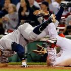 Alex Rodriguez crashes into Red Sox first baseman James Loney as he reaches on an error during the ninth inning of a game at Fenway Park.