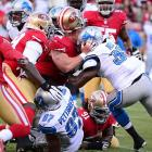 The typically ferocious 49ers defensive tackle Justin Smith loses his helmet trying to tackle running back Joique Bell (35) of the Lions.