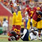 USC running back Silas Redd got flipped on his head after being tackled by Cal cornerback Steve Williams.