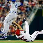 Nationals' third baseman Ryan Zimmerman rolls over and is able to tag the Dodgers' Adrian Gonzalez.