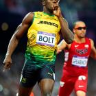 """Four years after electrifying the world with world records and a cocky but delightful self-assurance, Usain Bolt repeated as champion in both events. Bolt became the first sprinter to repeat in both as well as the first sprinter to repeat in the 200. Bolt had told the press all week that he would win both events, and after his victories he labeled himself """"the greatest athlete to live."""""""