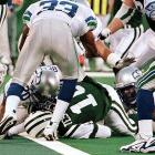 With 27 seconds left and the Seahawks leading 31-26 over the Jets, Vinny Testaverde burrowed through the line on fourth down from the 5-yard line. While Testaverde's helmet cross the plane of the goal line, the ball most efinitely did not -- not even close. Yet line judge Earnie Frantz, perhaps influence by the home crowd and the New York players raising their hands in approval, signaled the winning touchdown. The play was widely attributed with ushering instant replay into the NFL.