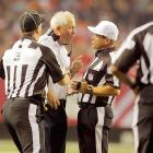 John Fox appears to be mincing few words in making a point to referee Tim Morris during the Broncos 27-21 loss to Atlanta.