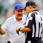 Buffalo coach Chan Gailey expresses his discontent with head linesman Michael Bell during his team's first game against the New York Jets.