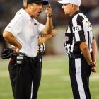 John Harbaugh firmly disagrees with whatever referee Richard Nicks is arguing.