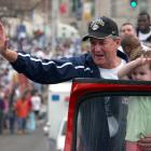 After beating Georgia Tech for his second national title, Calhoun waves to fans during a UConn victory parade.