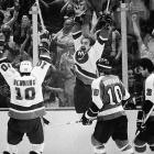 Up three games to two, Bobby Nystrom's first goal of the match gives the Isles a 4-2 lead late in the second period of Game 6. Then the favored Flyers, who had set an NHL record by going 35 games without a loss during the regular season, tie the score on third-period tallies by Bob Dailey and John Paddock. The packed Coliseum is on edge during the tense overtime until Nystrom tips John Tonelli's pass past Pete Peeters at 7:11 to give the Isles their first Stanley Cup.