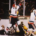The Isles' Cup fourpeat would have ended prematurely if not for their dramatic comeback against the Penguins in the deciding fifth game of their opening round. New York trails 3-1 in the third period against the scrappy Pens before goals by Mike McEwen at 14:33 and John Tonelli at 17:39 send the game to overtime where Tonelli strikes again at 6:19 of the extra session to propel the Isles on their way to their third consecutive championship.