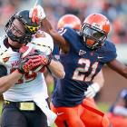 Cavaliers safety Brandon Phelps tried to get a head after Terrapin tight end Matt Furstenburg secured the pigskin. The Terps came out on top, 27-20, at Scott Stadium in Charlottesville, VA.