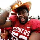 Speaking of valuable prizes, the Oklahoma offensive lineman donned the natty hat his Sooners won after trouncing Texas, 63-21, at the Cotton Bowl in Dallas.