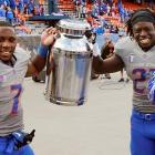 In the land of Milk Can and Honey Badger, Boise State is king. Broncos D.J. Harper and Jay Ajayi hoist their valuable prize after beating Fresno State, 20-10..