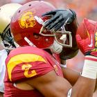 """Colorado DB Kenneth Crawley plays a little game of """"Guess Who?"""" with wideout Robert Woods, who happens to have a touchdown reception there in his hands. It seems Mr. Crawley and Co. should have focused a bit more on football, as they were soundly defeated, 50-6."""