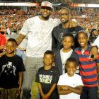 The happy couple and their kids graced the sidelines at Sun Life Stadium before  the Florida State Seminoles met the Miami Hurricanes for a friendly game of tackle football.