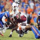 Running back Mike Davis ended up on top, but his Gamecocks did not against the Gators, who won 44-11.