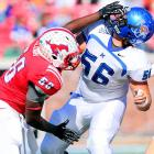 Mustangs linebacker Ja'Gared Davis makes a head-turning play against Tigers lineman Chris Schuetz.