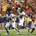 Geno Smith's Heisman candidacy remains intact, as do West Virginia's Big 12 and BCS prospects. Smith (pictured) out-dueled Texas counterpart David Ash, throwing four touchdown passes in another thrilling shootout. The Mountaineers also got a boost from their run game, as Andrew Buie rushed for 207 yards and two touchdowns in the win.