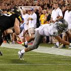 Oregon's offense showed just how explosive it can be during its Thursday night showdown with Arizona State. The Ducks exploded for 43 points in the first 19 minutes before cruising to a rout of the previously surging Sun Devils. Running back Kenjon Barner rushed for 143 yards and three touchdowns, while quarterback Marcus Mariota (pictured) carried 10 times for 135 yards and a score. Oregon's defense also stepped up. After allowing a 28-yard touchdown pass on Arizona State's first offensive play from scrimmage, the Ducks held the Sun Devils scoreless until the closing moments of the fourth quarter.