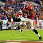Florida's undefeated season is no more. Georgia seized control of the SEC East race by outlasting the Gators in Jacksonville. Todd Gurley rushed for 118 yards and a touchdown, and Aaron Murray connected with Malcolm Mitchell (pictured) for a 45-yard score in the fourth quarter. But real story was the Bulldogs' defense. Georgia manufactured six turnovers -- including Jarvis Jones' forced fumble of Jordan Reed to clinch the victory.
