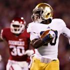 If there was any remaining doubt, the Irish proved that they're finally back with a statement victory over Oklahoma in Norman. Quarterback Everett Golson came into his own by amassing 241 total yards and a touchdown, and running backs Theo Riddick and Cierre Wood (pictured) both rushed for 74 yards and a score. The Notre Dame defense also lived up to its billing. Manti Te'o and Co. surrendered just 15 rushing yards and limited the Sooners to 4-of-14 third-down conversions.