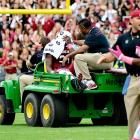 South Carolina hung on to beat Tennessee Saturday, but it lost something more important: Star running back Marcus Lattimore (pictured) suffered a gruesome knee injury in the second quarter and was carted off the field and taken to the hospital. Backup running back Kenny Miles and quarterback Connor Shaw each rushed for 34 yards after Lattimore went down.
