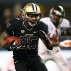 Down goes another top-10 team. On a Saturday in which Florida, Oklahoma and USC had already lost, Oregon State added to the Week 9 BCS shakeup by falling on the road to Washington. Huskies running back Bishop Sankey (pictured) collected 92 rushing yards and two touchdowns, while Beavers quarterback Sean Mannion tossed four interceptions. Washington's Travis Coons kicked the game-winning 30-yard field goal with 1:20 remaining.