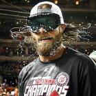 Beer goggles: The outfielder shook off the suds after his Washington Nationals clinched the NL East title.