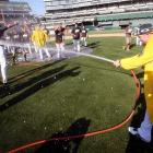 The amazing A's had to be hosed down after the AL West was won with their triumph over Texas. Alas, they were ultimately cooled off by Detroit in the AL Division Series.