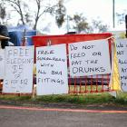 By the looks of those signs, these gents in Bathurst, Australia, have been drinking something a bit stronger than V8.