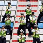 The dance craze that's sweepin' the land   IS SO HOT   that even South Korean coppers can't stop doing it in the stands at the Korean International Circuit.