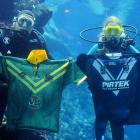 Though a match rarely lights underwater, these divers off Australia nevertheless insisted that they discovered evidence of deep sea rugby played by the Australian Kangaroos and New Zealand Kiwis.