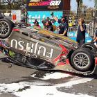 From Australia's Gold Coast Street Circuit, what looks like evidence of at least one reason why you should never drink and drive: you will spill yer beer.
