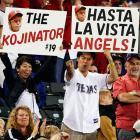 Rangers fans hold signs for relief pitcher Koji Uehara (aka - The Kojinator).