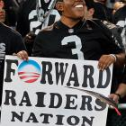 President Obama takes a stop from the campaign trail to take in a Raiders game.