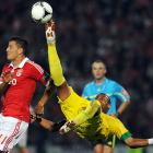 Pacos Ferreira's Ricardo Silva, right, goes airborne to reach for the ball with Benfica's Rodrigo Lima during a Portuguese League soccer match at Mata Real stadium in Pacos de Ferreira, Portugal.