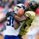 Duke's Tony Foster breaks up a pass intended for Sherman Raglund III of Wake Forest. The Blue Devils defeated the Demon Deacons 34-27.