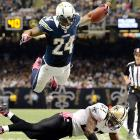 The Chargers' Ryan Mathews dives over the Saints' Malcolm Jenkins to score a touchdown during the third quarter of their Sunday night game.