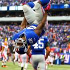 The Giants' David Wilson celebrates his touchdown against the Browns by doing a backflip.