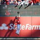 The Nationals' Jayson Werth leaps to make a spectacular catch at the scoreboard against the Cardinals in Game 1 of the National League Division Series in St. Louis.