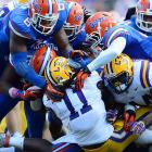 LSU running back Spencer Ware gets steamrolled by a mass of Florida defenders during the Gators' 14-6 win over the Tigers.
