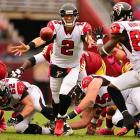 Falcons quarterback Matt Ryan pitches a reverse to Harry Douglas during their win over the Redskins.