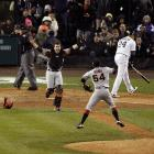 Buster Posey and Sergio Romo celebrate after sweeping the Detroit Tigers in the World Series.