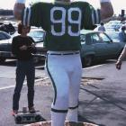 A fan pays tribute to Gastineau and his sack dance in the parking lot outside a Jets game.