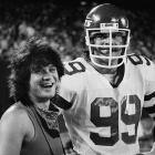 Gastineau invites celebrity friend and Van Halen guitarist Eddie Van Halen to the sideline during a game.