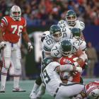 Patriots QB Tony Eason gets pigpiled by Lance Mehl (56), Joe Klecko (73), Mark Gastineau (99), and Lester Lyles (26) during a 1985 game against the Jets.