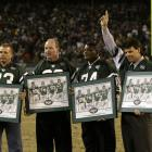 The Jets Sack Exchange -- Joe Klecko, Marty Lyons, Abdul Salaam, and Mark Gastineau -- accept on field honors during halftime of a 2001 Jets-Broncos game.